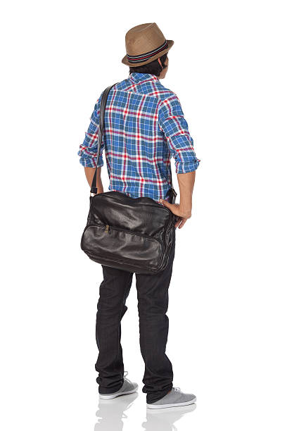 Rear view of a man standing Rear view of a man standinghttp://www.twodozendesign.info/i/1.png akimbo stock pictures, royalty-free photos & images