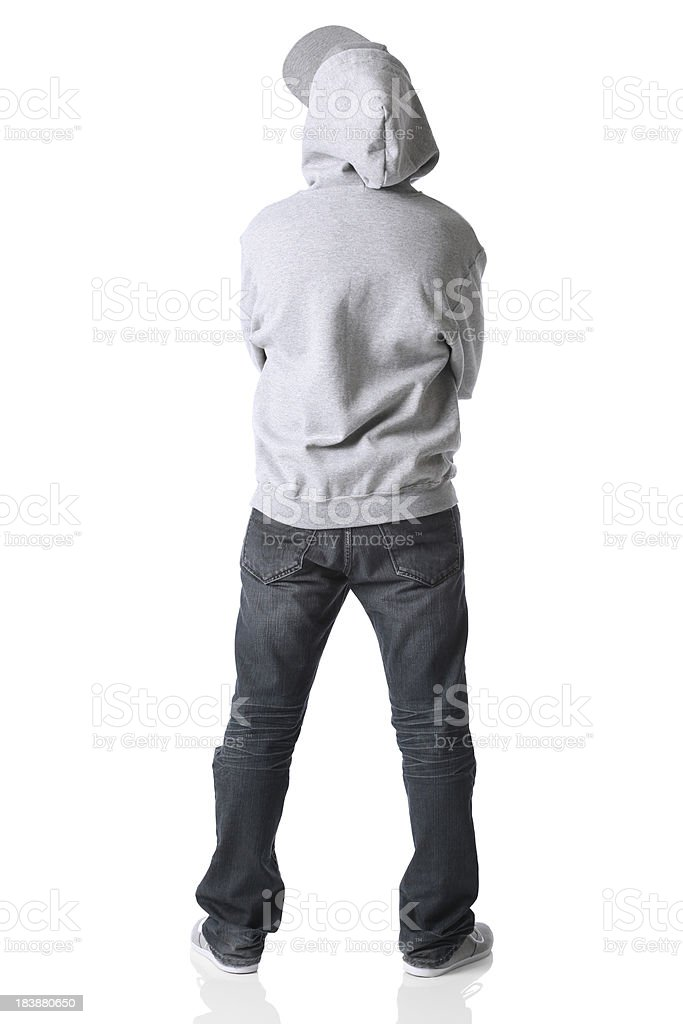 Rear view of a man standing with arms crossed royalty-free stock photo
