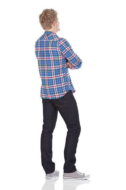 rear view of a man standing with arms crossed - rear view stock photos and pictures