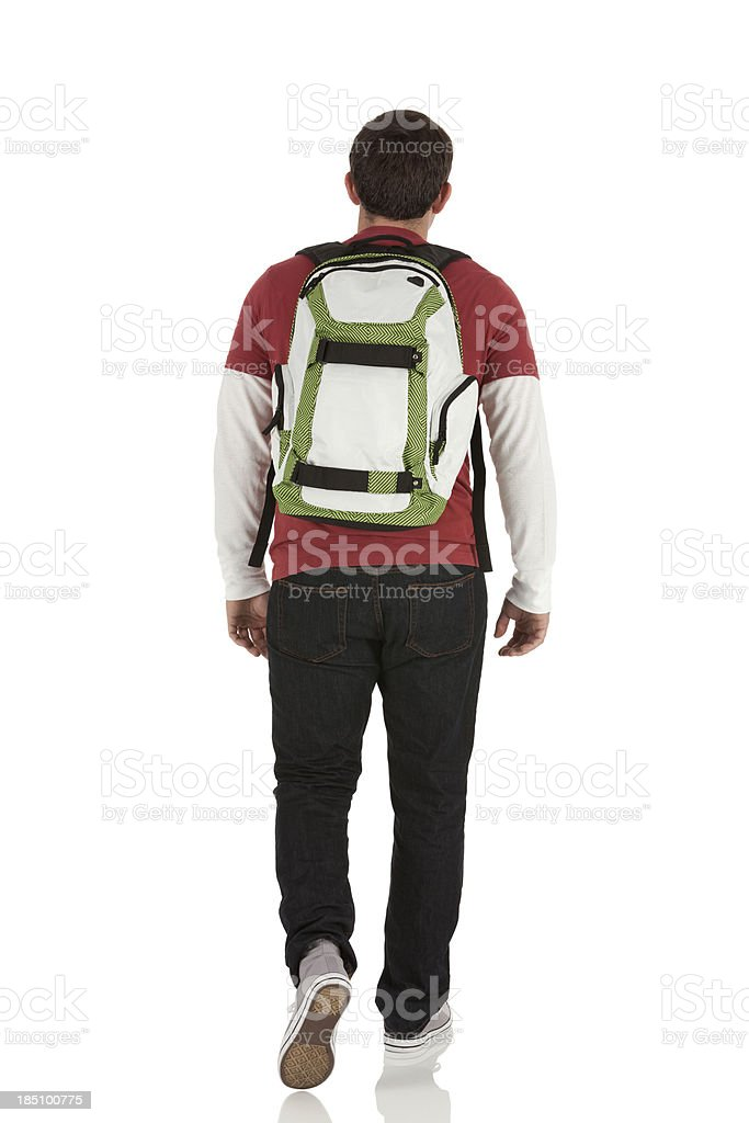 Rear view of a man walking stock photo