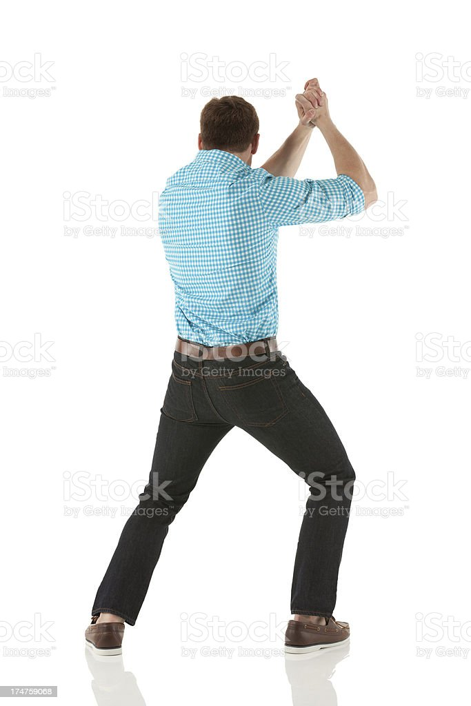 Rear view of a man with hands clasped stock photo
