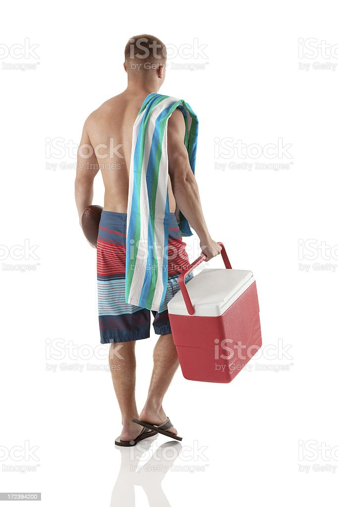 Rear view of a man with ice box and towel royalty-free stock photo