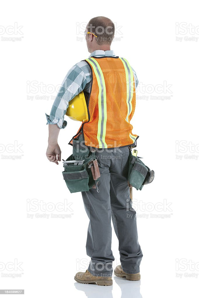 Rear view of a manual worker with hardhat royalty-free stock photo