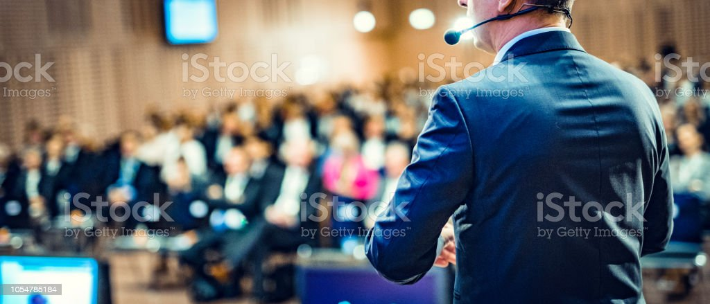 Rear view of a motivational coach giving a speech - Royalty-free Adult Stock Photo