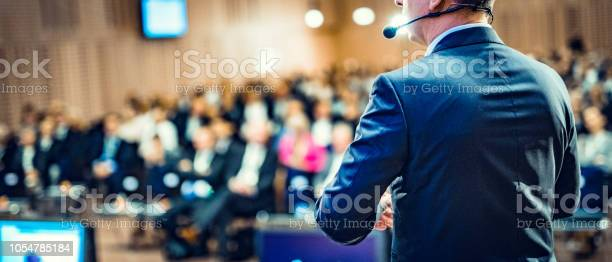Rear View Of A Motivational Coach Giving A Speech Stock Photo - Download Image Now