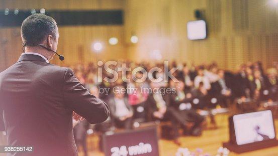 938409136 istock photo Rear view of a motivational coach giving a speech 938255142