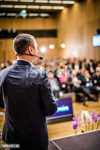 istock Rear view of a motivational coach giving a speech 938409136
