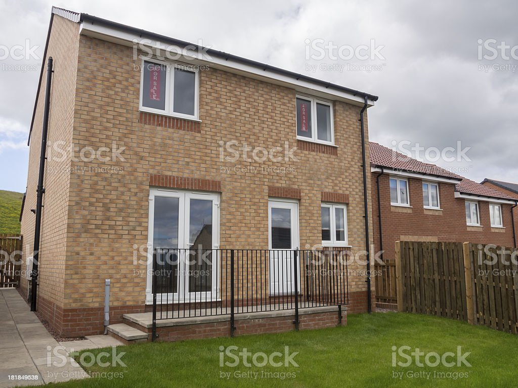 Rear view of a newly built detached house. stock photo