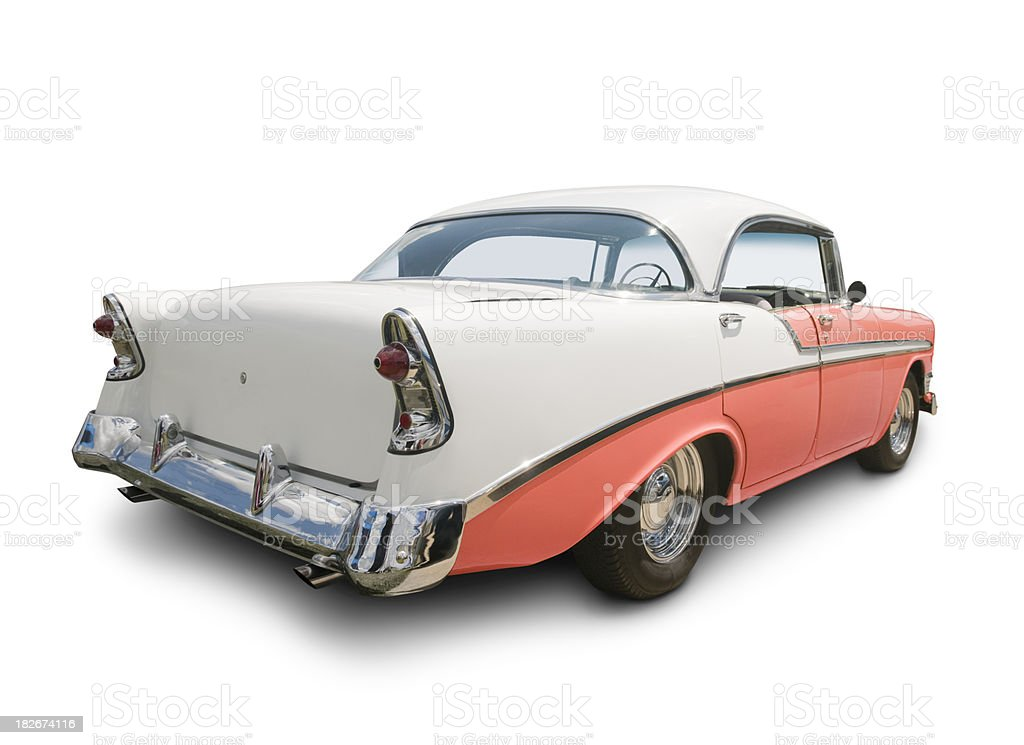 Rear view of a peach-and-white 1955 Chevy sedan stock photo