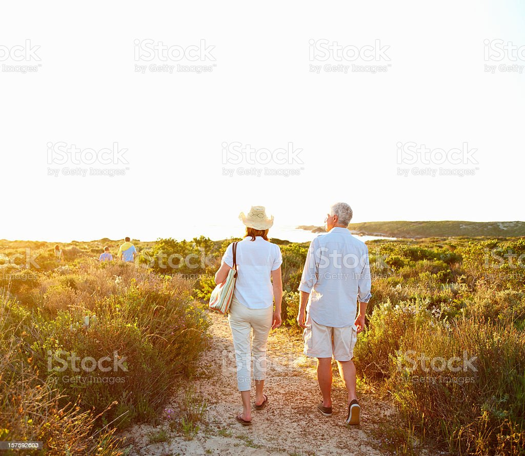 Rear view of a retired couple walking together stock photo