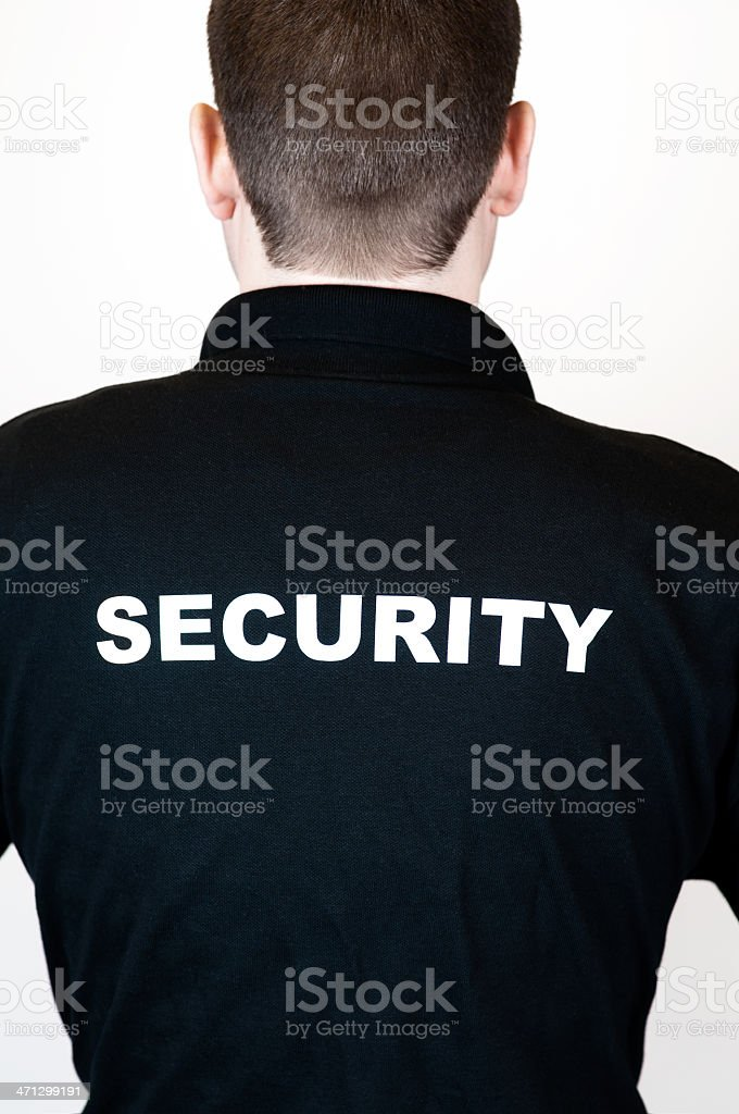 Rear view of a security guard in black t-shirt royalty-free stock photo