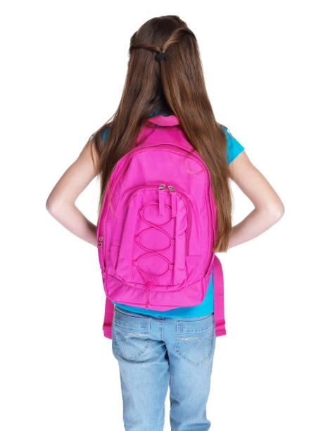 widok z tyłu mała dziewczynka stojący z schoolbag - back to school zdjęcia i obrazy z banku zdjęć