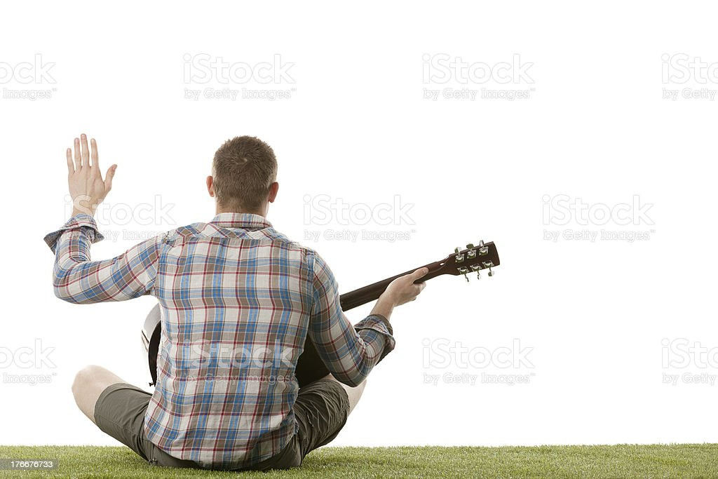 Rear view of a street musician with guitar royalty-free stock photo