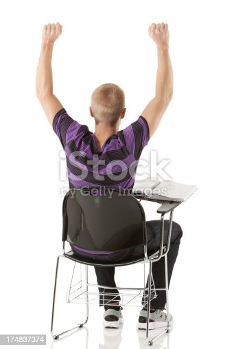istock Rear view of a student with hands raised 174837374