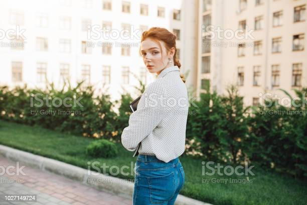 Rear view of a teenager student red hair girl on the city street a picture id1027149724?b=1&k=6&m=1027149724&s=612x612&h=oaloqeu3r8aadlbj1s2e7x7esksq3l44rlbjxtjykp8=