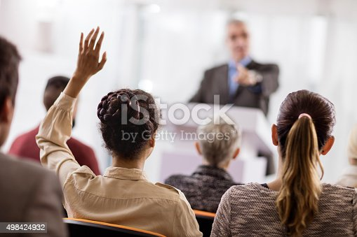 istock Rear view of a woman asking a question on seminar. 498424932