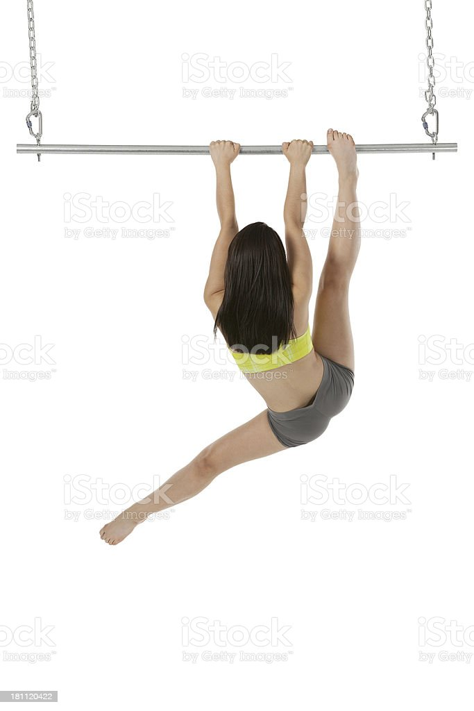 Rear view of a woman climbing on gymnast bar stock photo