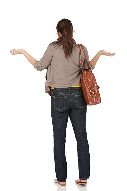Rear view of a woman gesturing stock photo