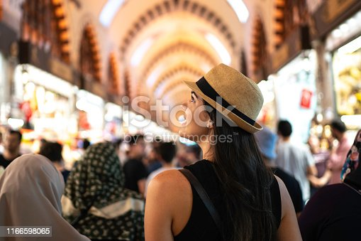 Rear view of a woman in awe at a grand bazaar