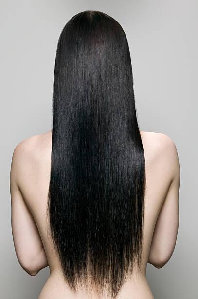 背面の女性 - 人の髪 ストックフォトと画像