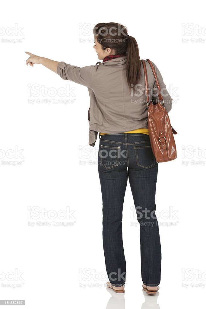 Rear view of a woman pointing stock photo