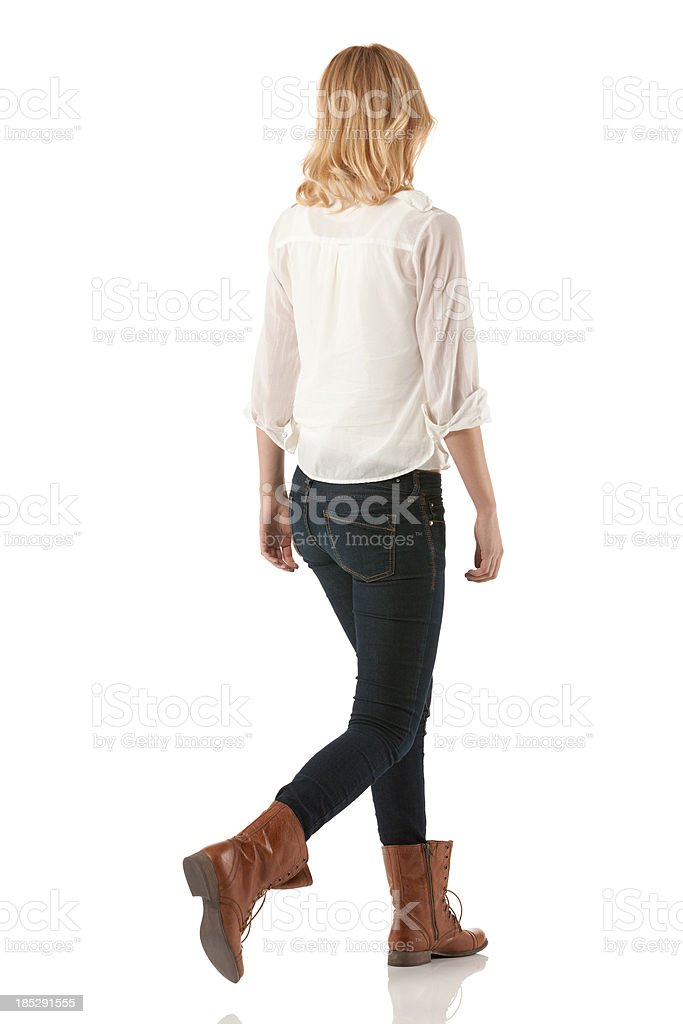 Rear view of a woman walking stock photo