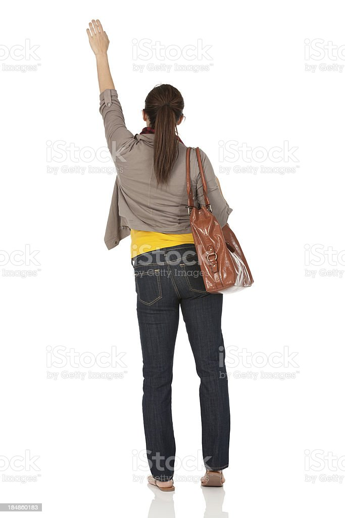 Rear view of a woman waving her hand stock photo