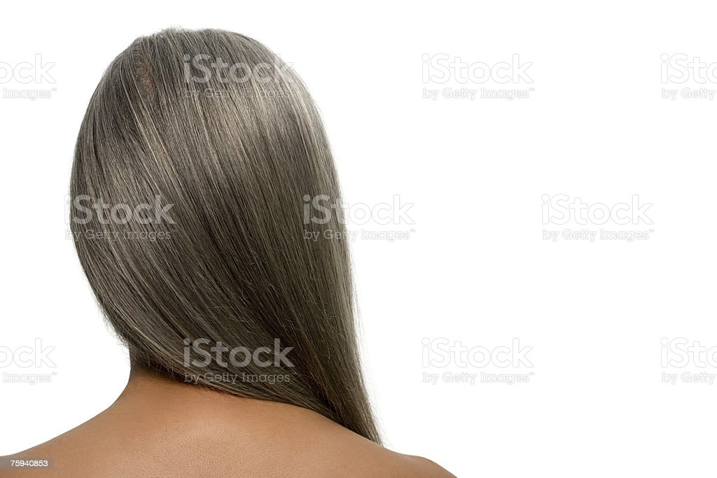 Rear view of a woman with gray hair stock photo