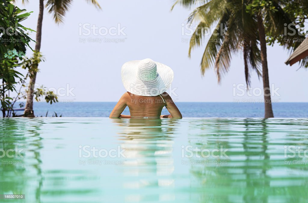 Rear view of a woman with  hat. royalty-free stock photo