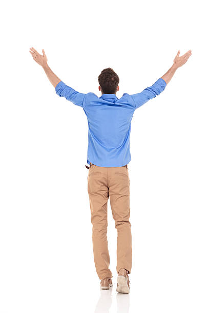 rear view of a young casual man - arms outstretched stock photos and pictures