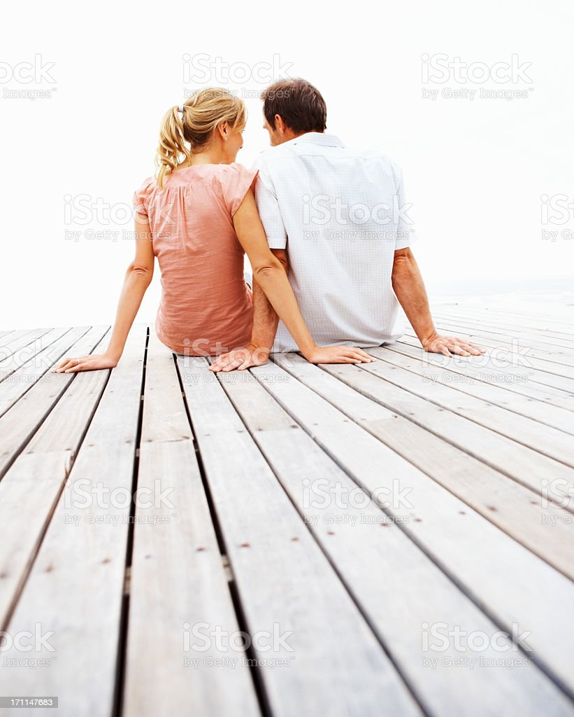 A rear view of a young couple outdoors royalty-free stock photo