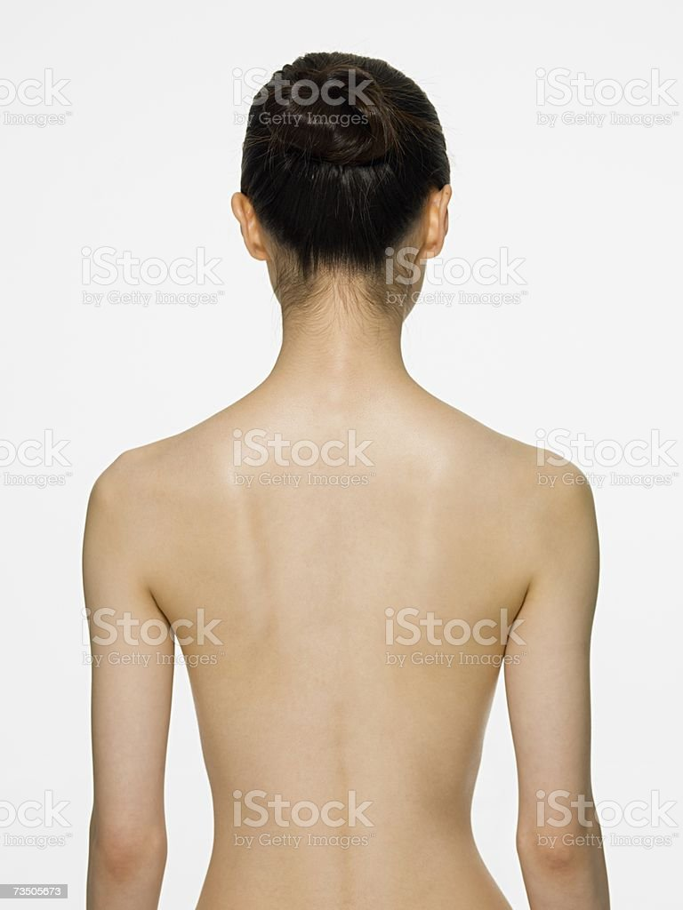 Rear view of a young woman stock photo