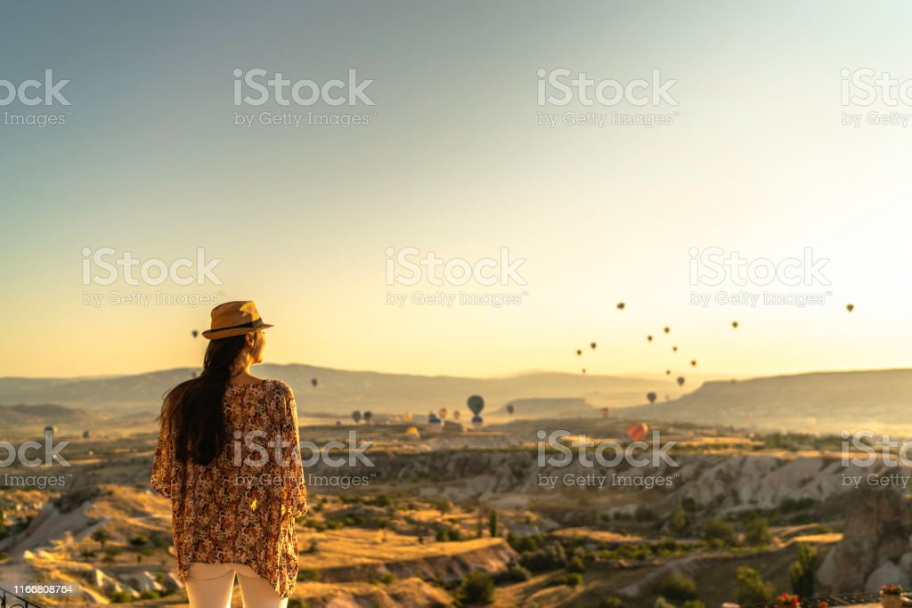 Rear View Of A Young Woman Standing And Looking At View During...