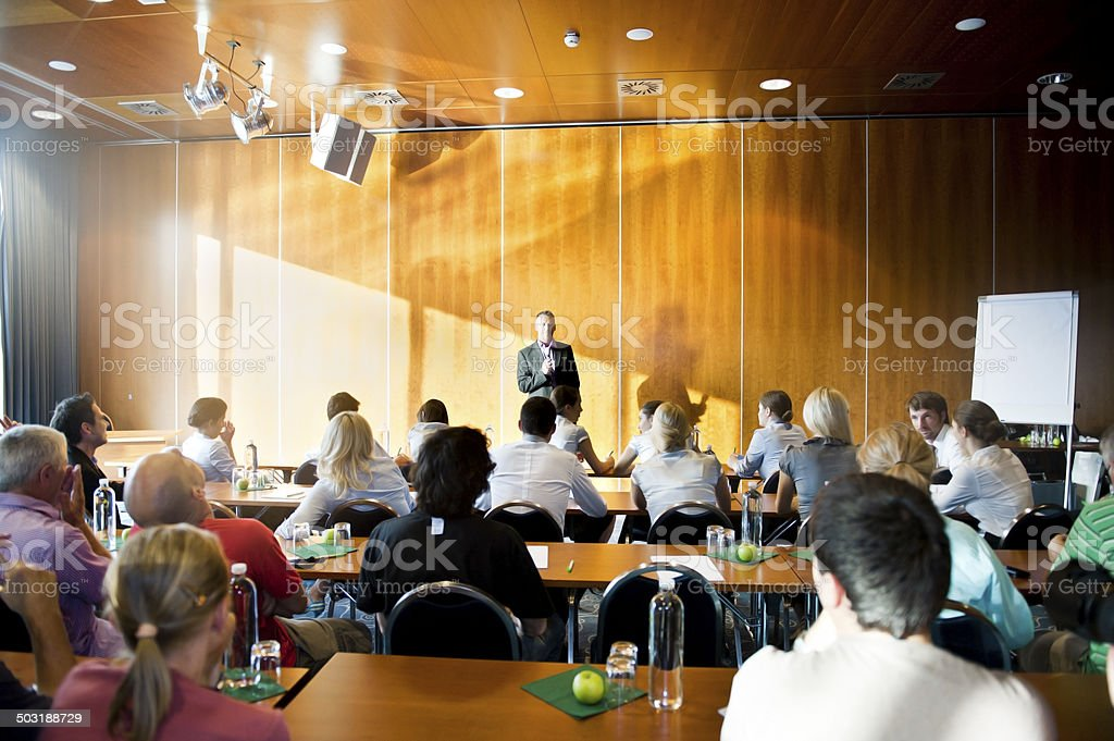 Rear view of adult students  on seminar stock photo