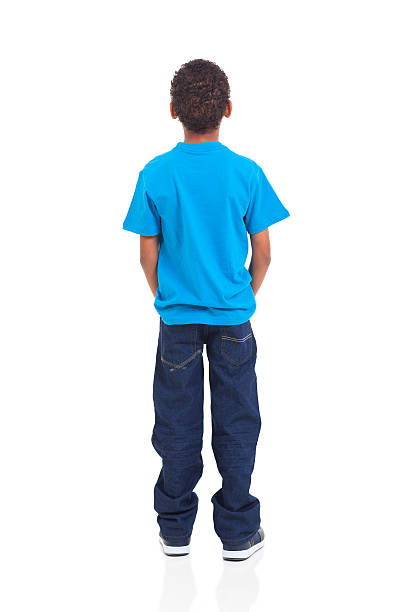 rear view of african american boy on white - rear view stock photos and pictures