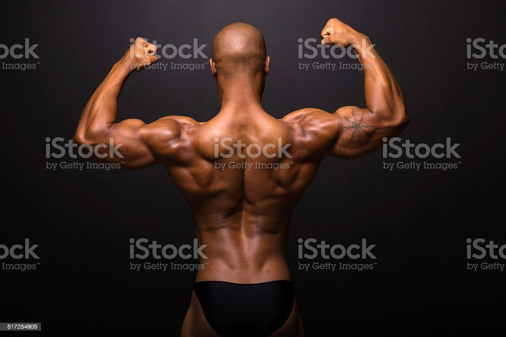rear view of afro american male bodybuilder posing stock photo