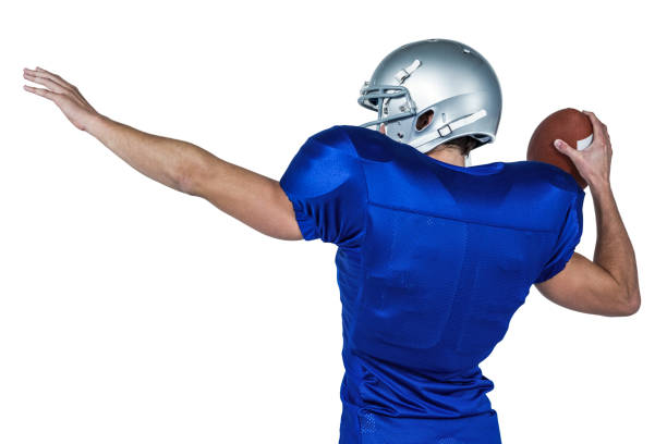 Rear view of American football player throwing ball Rear view of American football player throwing the ball against white background quarterback stock pictures, royalty-free photos & images
