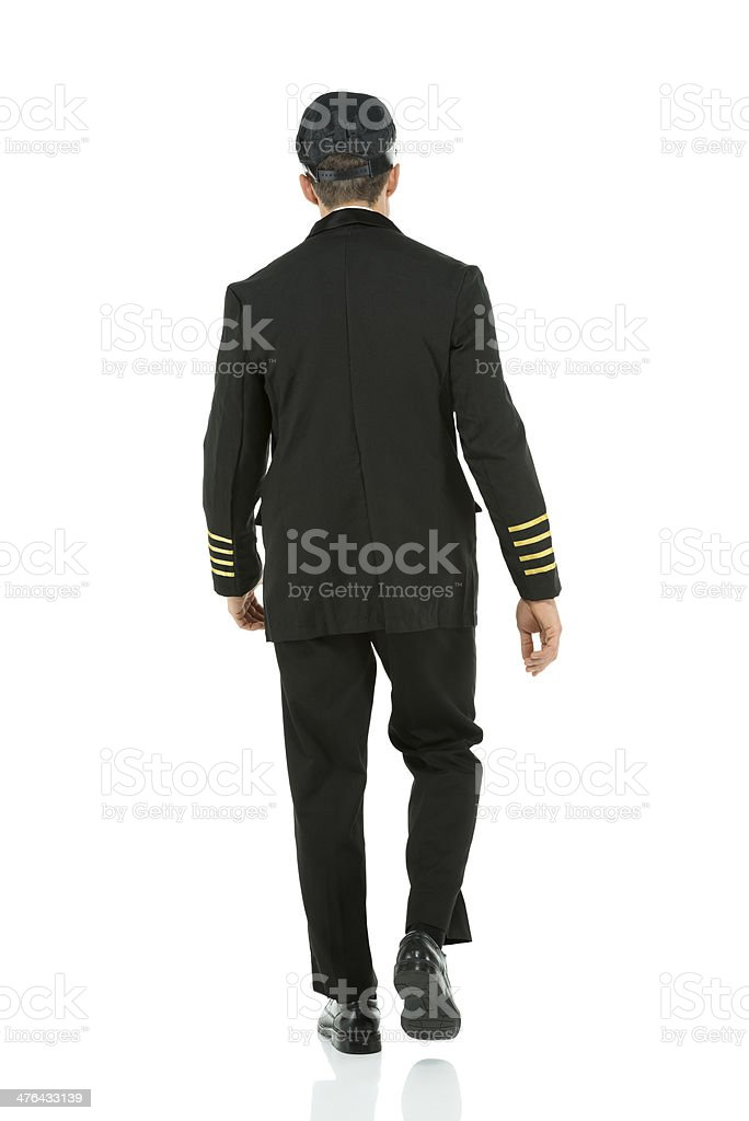 Rear view of an airlines pilot walking royalty-free stock photo