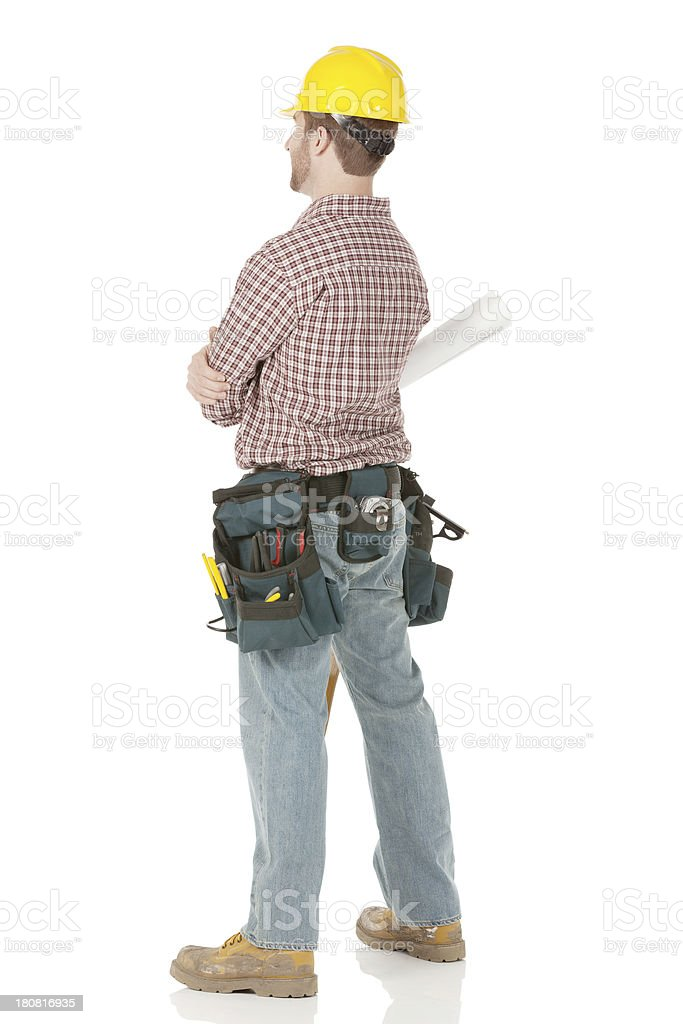 Rear view of an architect standing royalty-free stock photo