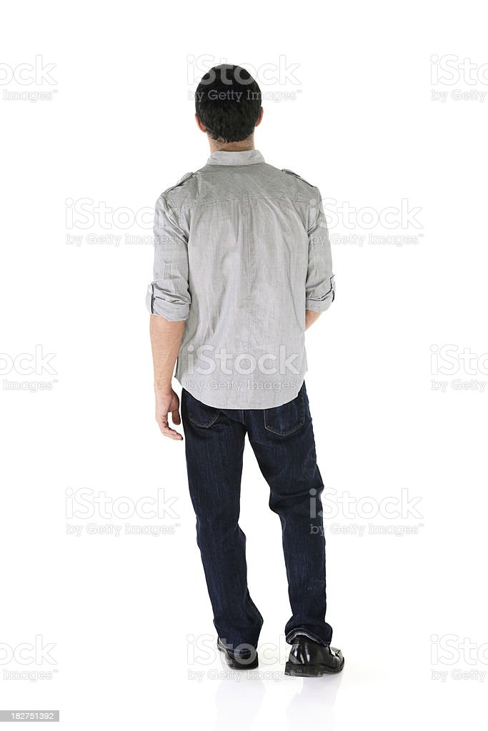 Rear view of an isolated casual male stock photo