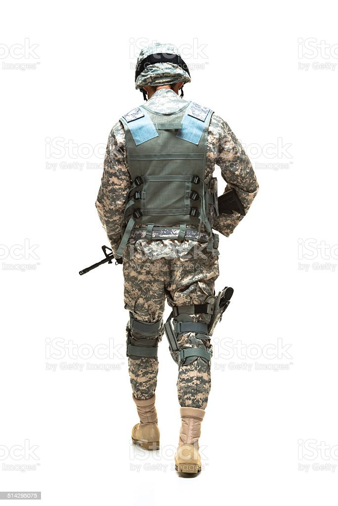 Rear view of army man walking stock photo