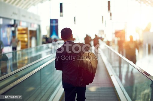 rear view of Asian businessman walking in departure area of  Shenzhen airport, China