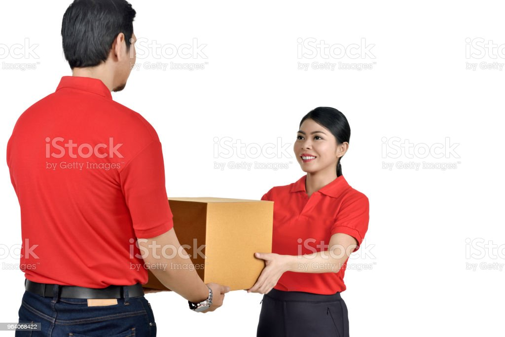 Rear view of asian courier man delivering the package to woman - Royalty-free Adult Stock Photo