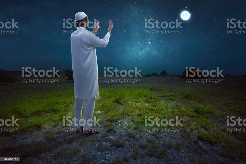 Rear view of asian muslim man praying stock photo