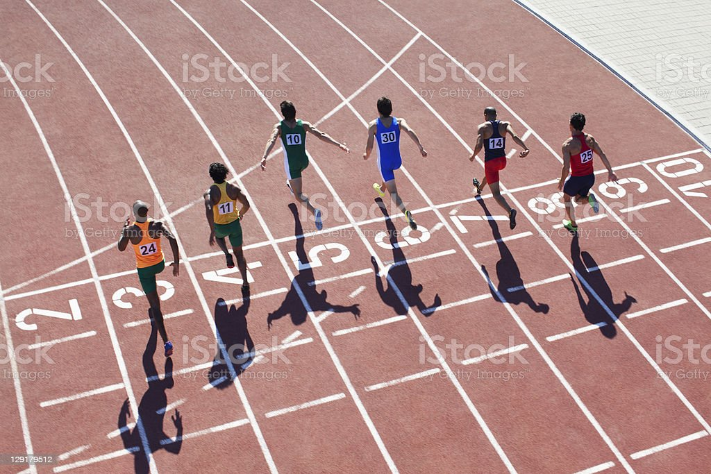 Rear view of athletes running royalty-free stock photo