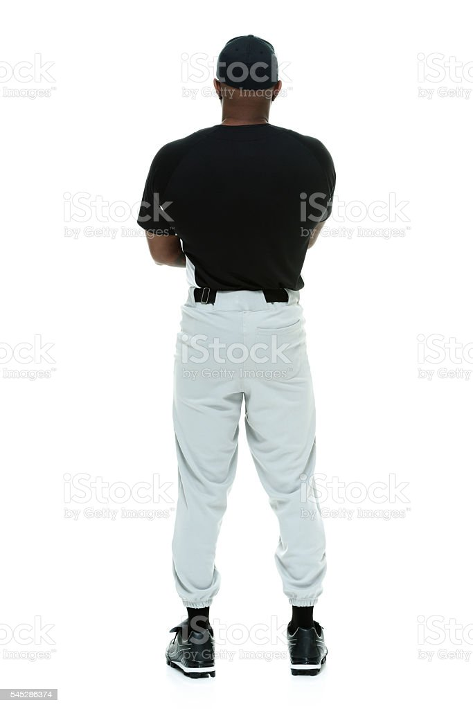Rear view of baseball player standing stock photo