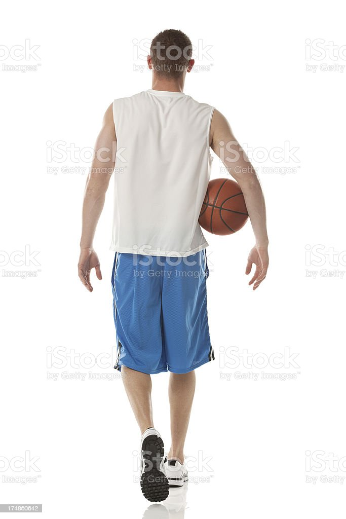 Rear view of basketball player walking royalty-free stock photo