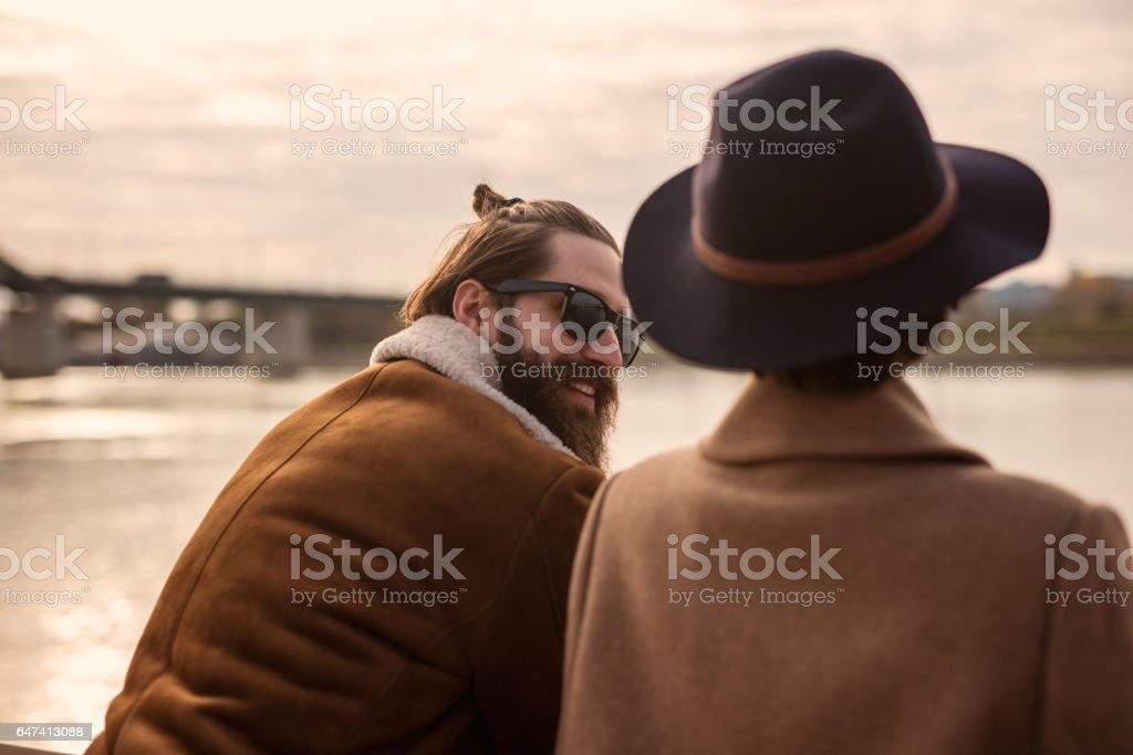 Rear View Of Bearded Guy With Long Hair In A Bun And His Female