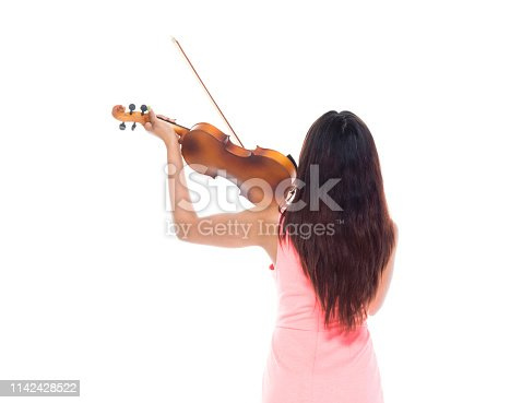 Rear view of beautiful female playing the violin