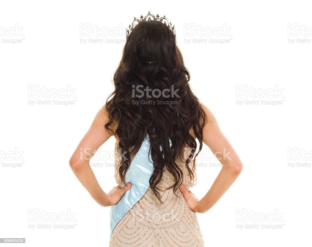 Rear view of beauty queen standing stock photo